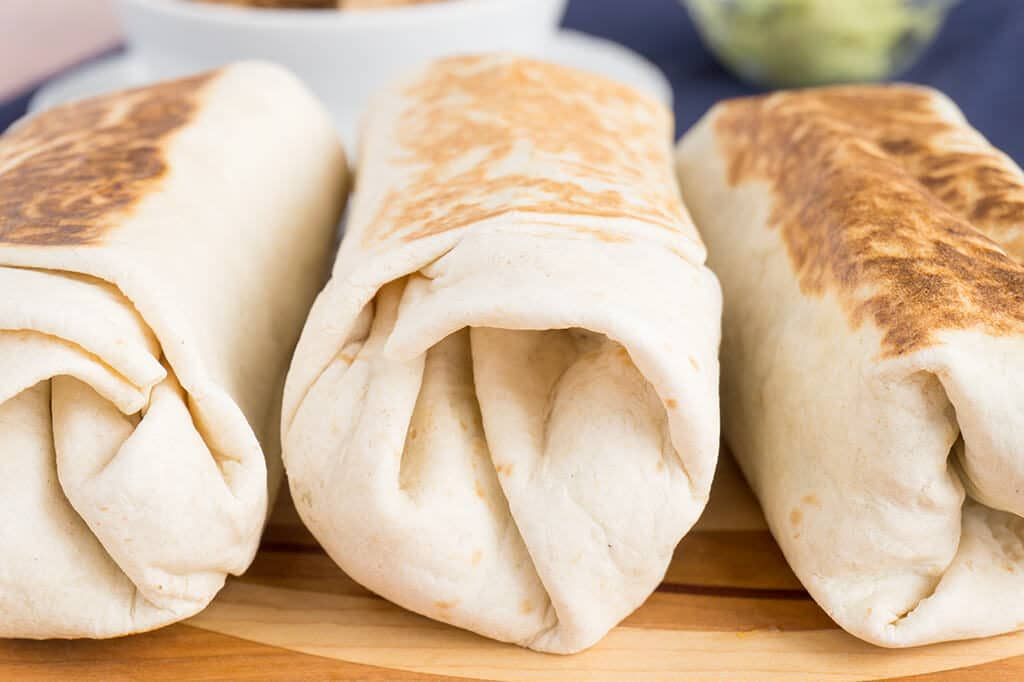 Spinach, Sweet Potato & Black Bean Burritos rolled up