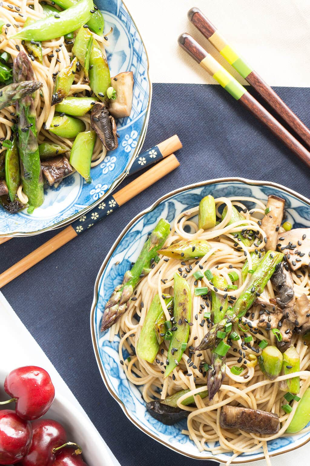 5 Minute Sesame Noodle Bowl with Spring Veggies. This super fast and healthy veggie bowl is light and fresh for spring featuring asparagus, snap peas and mushrooms tossed with a sesame-soy dressing. | VEGETARIAN | QUICK | LUNCH | ASIAN | NOODLES | Recipe at OatandSesame.com