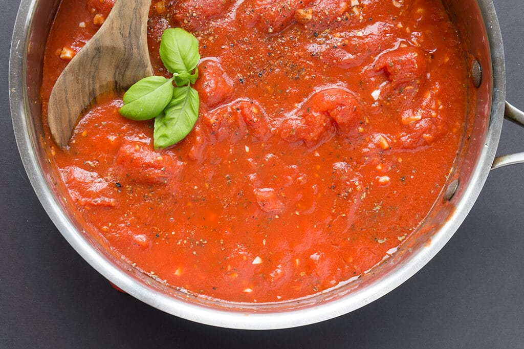 With just a few ingredients you can make a Simple Homemade Tomato Sauce that's WAAY better than any jarred sauce. Done in under 30 minutes, this versatile sauce can be used for pizza sauce, pasta sauce, dipping and spreading! | PASTA | TOMATO | SAUCE | ITALIAN | PIZZA | Recipe at OatandSesame.com