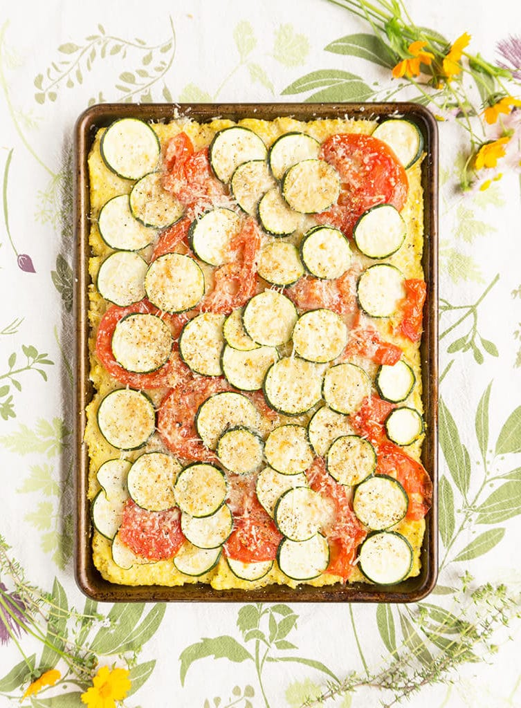 Herby Zucchini Tomato Baked Polenta overhead in pan