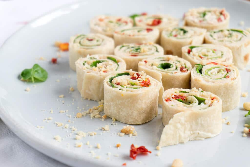 Sun-Dried Tomato, Basil and Spinach Pinwheels on platter