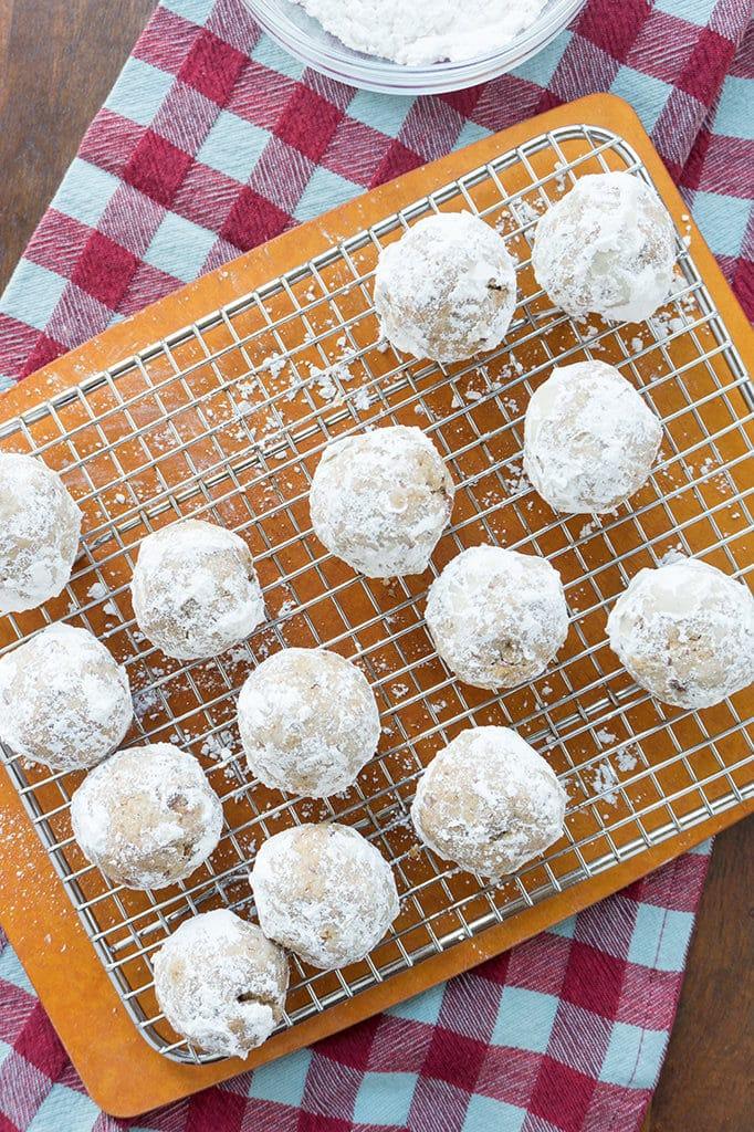 Maple Pecan Tea Cookies on rack with powdered sugar
