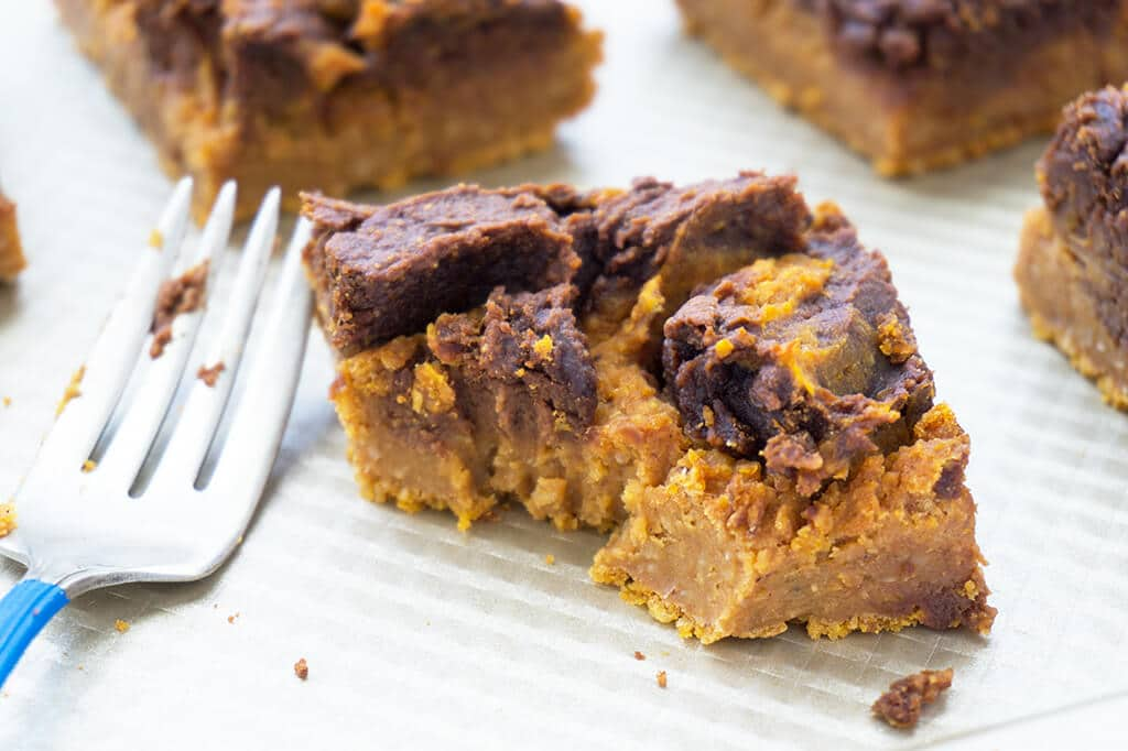 Vegan Pumpkin Pie Bars - square with bite missing