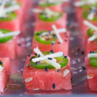 Watermelon cut into small squares topped with jalapeno