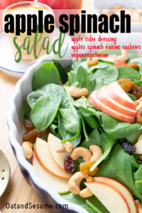 A BRIGHT AND CRISP APPLE SALAD! Packed with spinach, this Apple Spinach Salad with toasted cashews is dressed with a tangy apple cider vinaigrette and mixed with creamy cashews and sweet apple and raisins. | #AppleRecipes | #AppleSalad | #SaladIdeas | #VegetarianRecipes | #VeganSalads | #HealthyRecipes at OatandSesame.com #oatandsesame