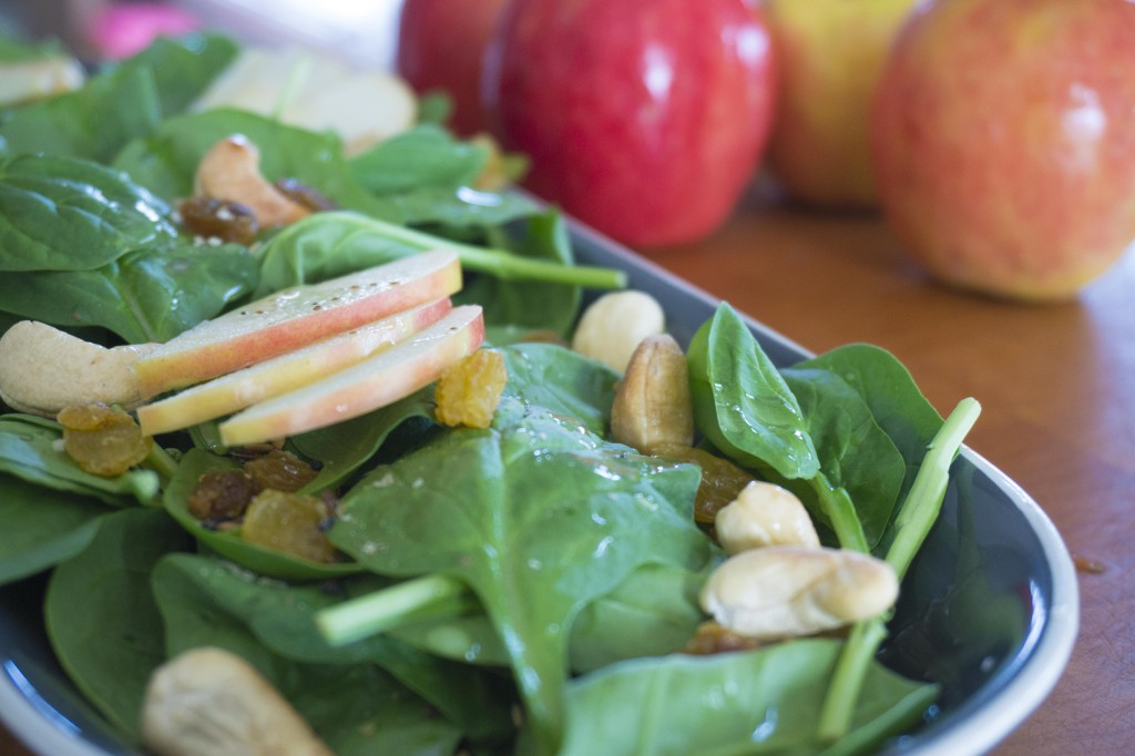 Apple-Cashew Spinach Salad on plate