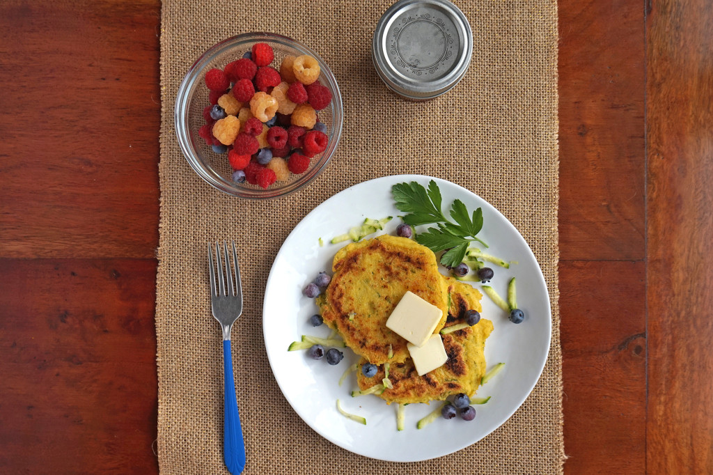 Zucchini Cornmeal Griddle Cakes overhead with bowl of raspberries