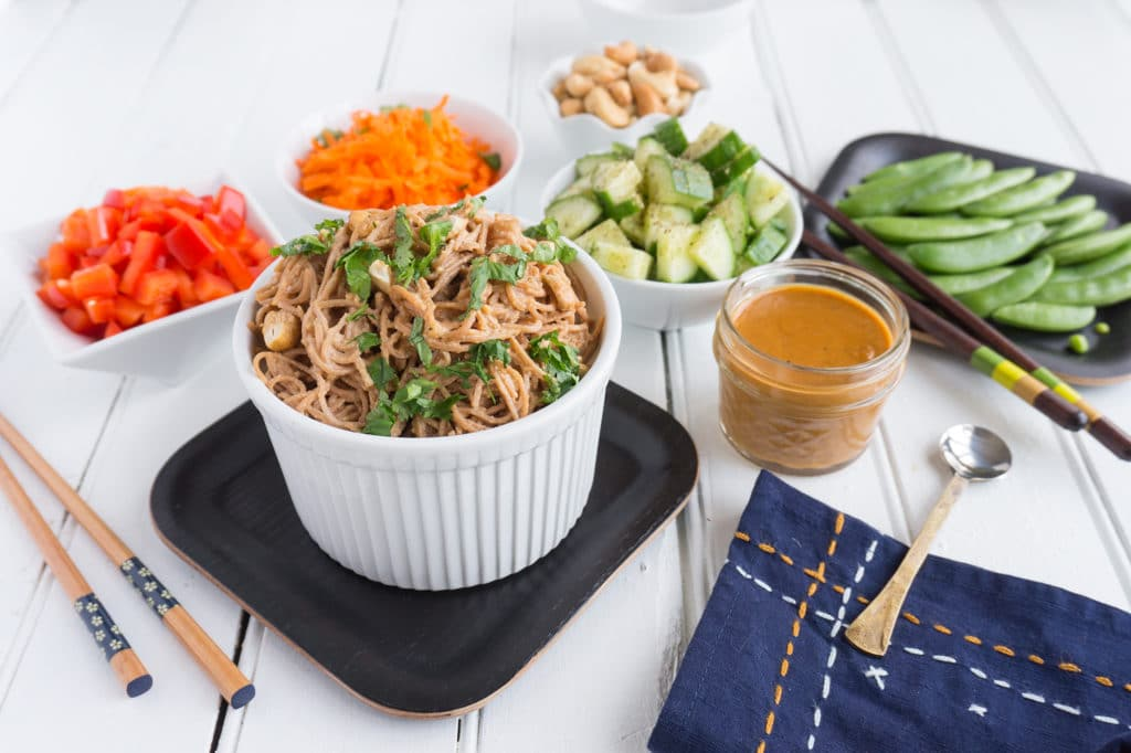 vegan soba noodle salad with vegetables in bowls