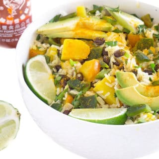 Tropical Black Beans and Rice Bowl has juicy mango, zesty lime, beans, rice and gets spiced up with a few dashes of turmeric and sriracha | PLANT BASED | VEGAN | VEGETARIAN | HEALTHY FOOD IN BOWLS | Recipe at OatandSesame.com