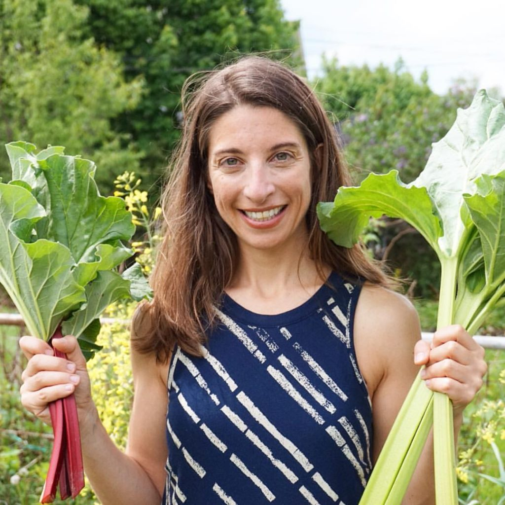 Emily with stalks of Rhubarb