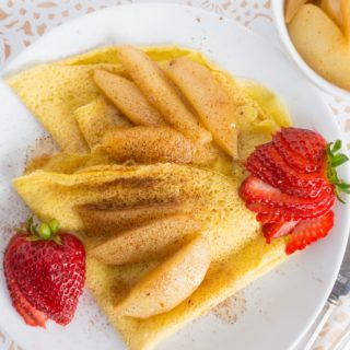 folded crepes with strawberries