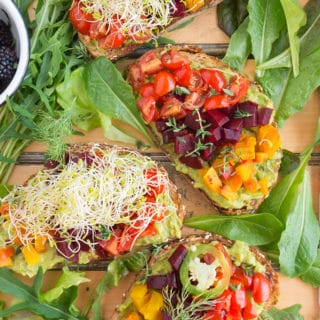 Beet & Avocado Open Faced Sandwich overhead shot with sprouts on top