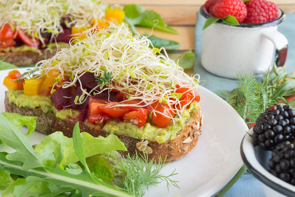 Beet & Avocado Open Faced Sandwiches on plate