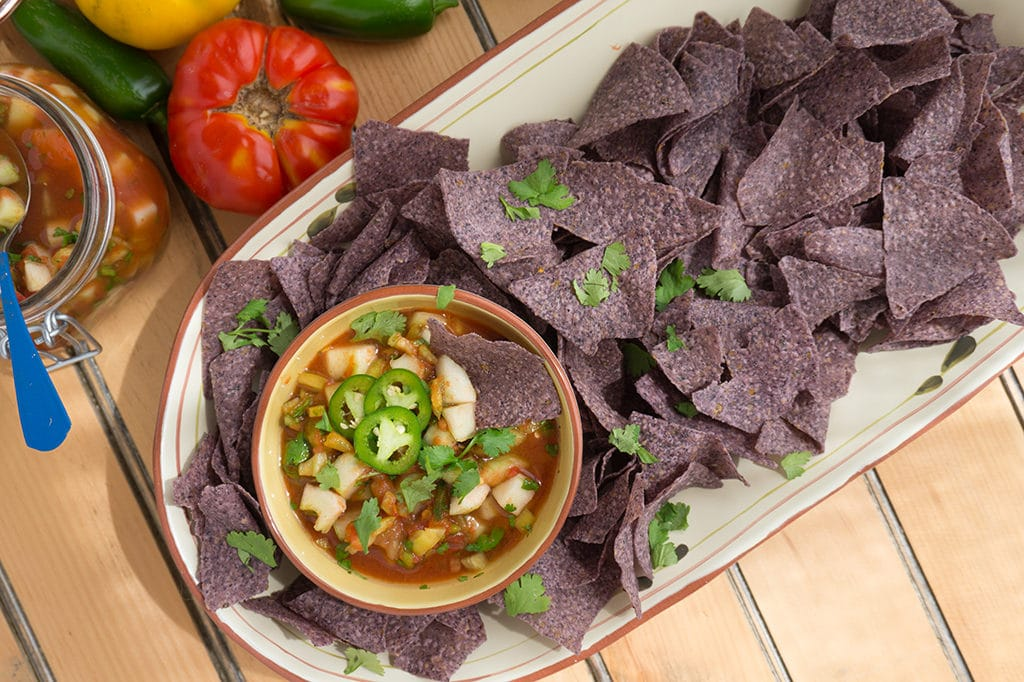 Cucumber Salsa overhead in bowl with chips