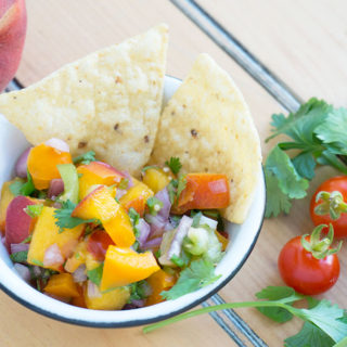 peach Salsa in a bowl with chips