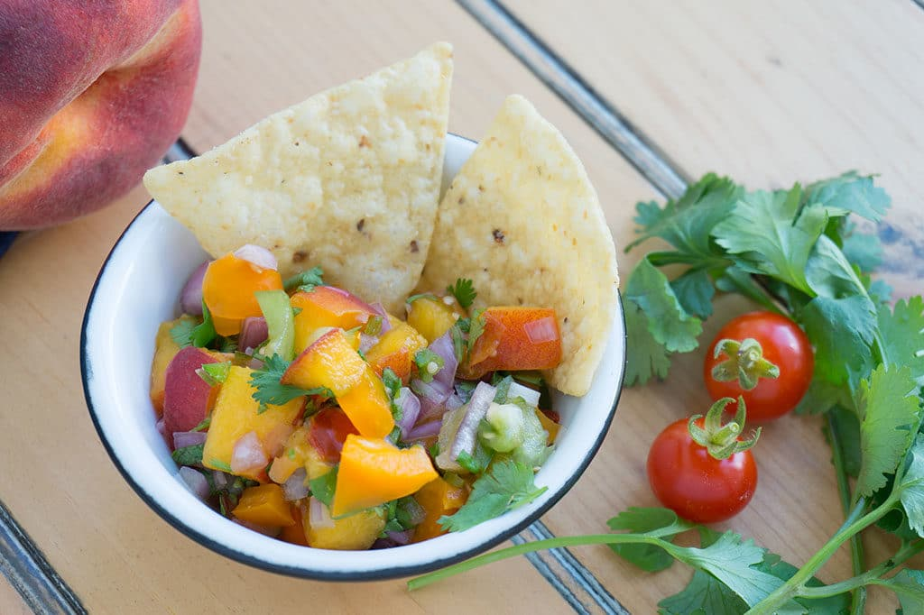 Peach Cilantro Salsa in little bowl with chips