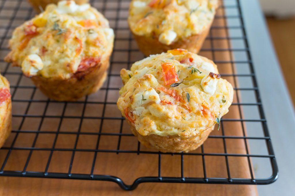 Savory Tomato, Zucchini, Corn and Feta Muffins on cooling rack