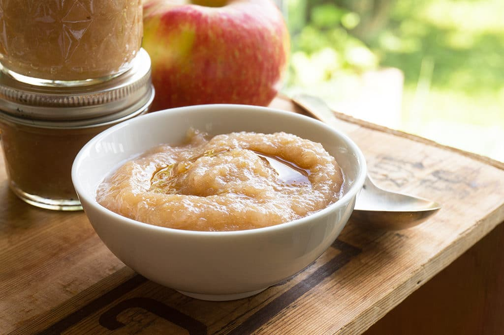 Maple Apple Sauce in bowl with swirl of maple syrup