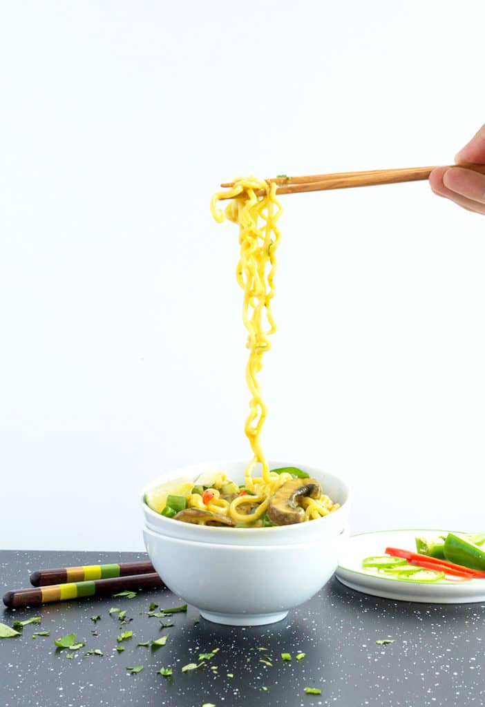 Thai Curly Coconut Curry Noodles hanging from chopsticks