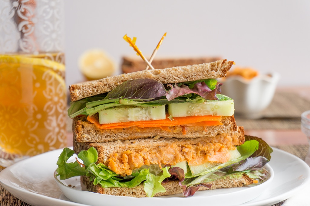 Sideview of sliced Roasted Chickpeas Veggie Sandwich