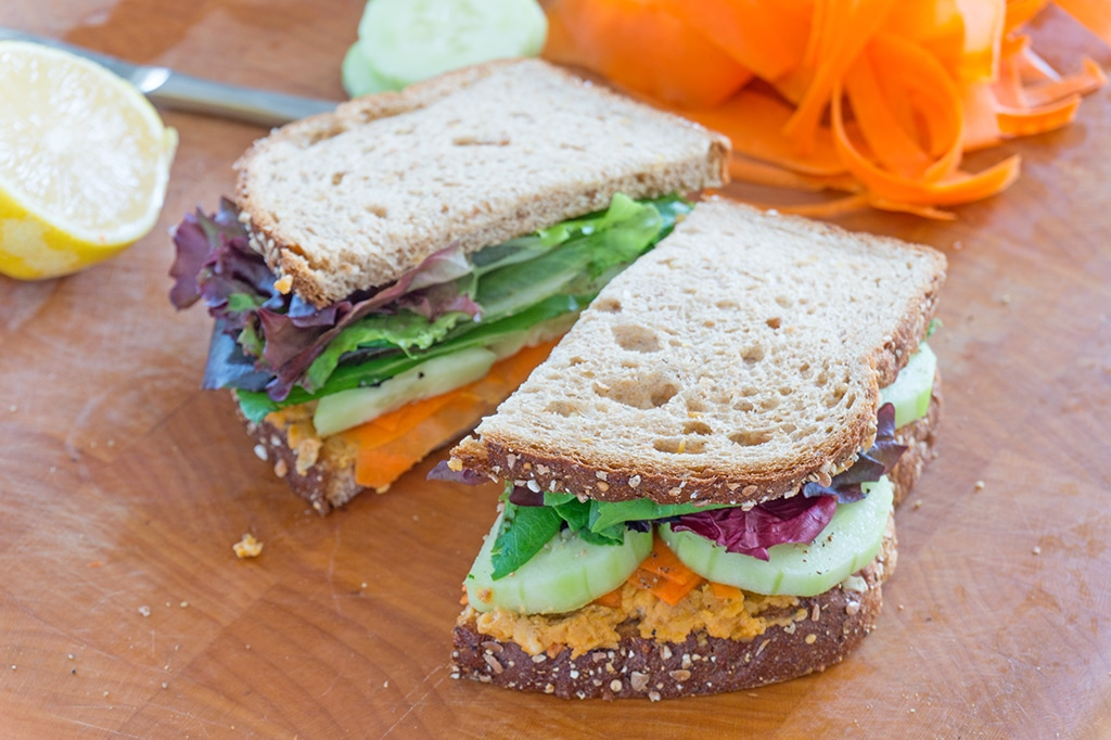 Roasted Chickpeas Veggie Sandwich sliced in two halves