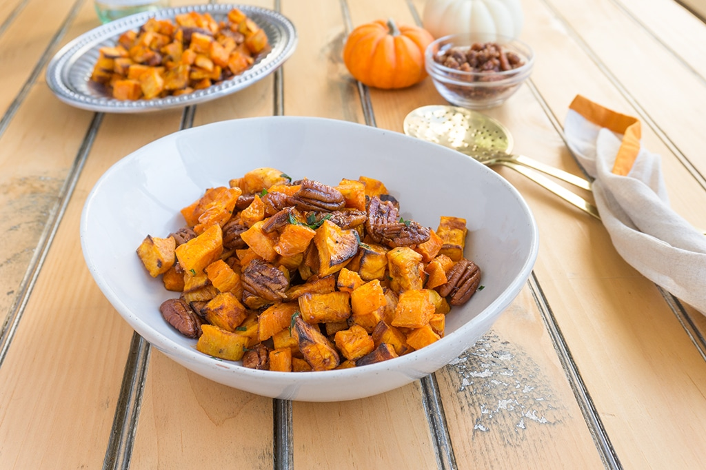 Roasted Sweet Potatoes with Apple Brandied Coconut Pecans in serving bowl