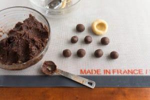 dough balls - inserting the chocolate balls into the vanilla outer dough