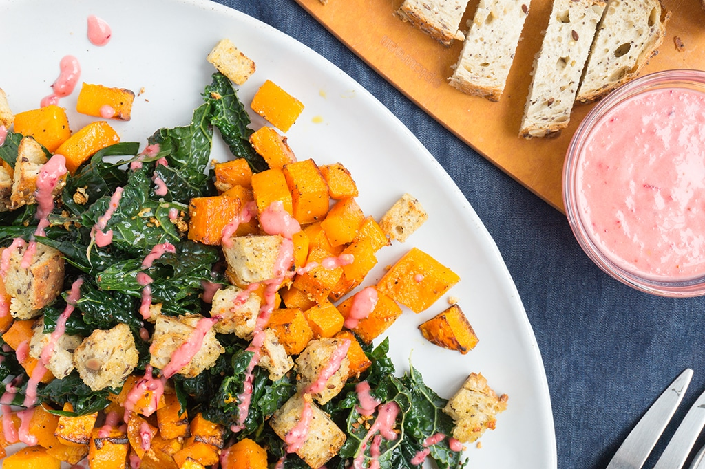 Roasted Butternut Squash Salad with Garlic Bread Bites close up on plate