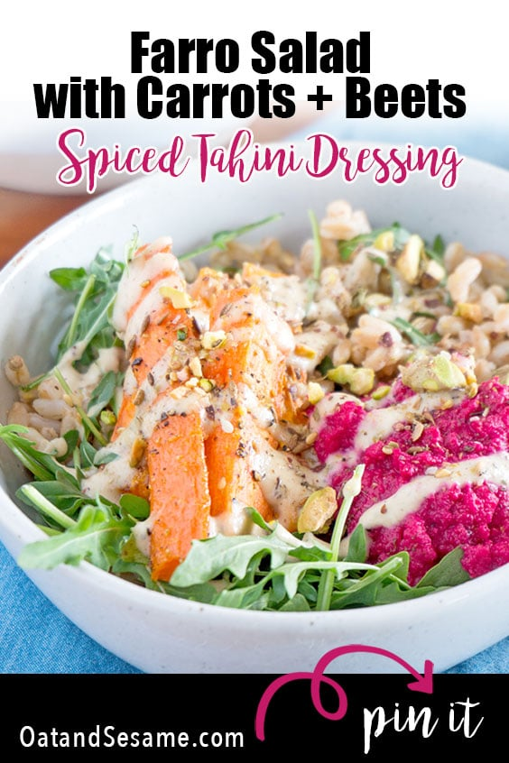 bowl of farro with pink hummus