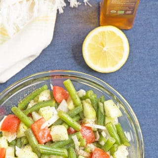 This Simple Moroccan Salad has cucumbers, green beans, tomatoes, and onions. All tossed with a lemon - Argan Oil vinaigrette. Follow my travels through Essaouira Morocco. | Recipe at OatandSesame.com