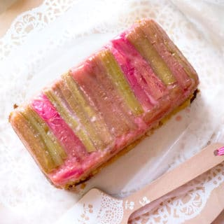 Vanilla Rhubarb Loaf Cake with strips of rhubarb lining the top of the cake.