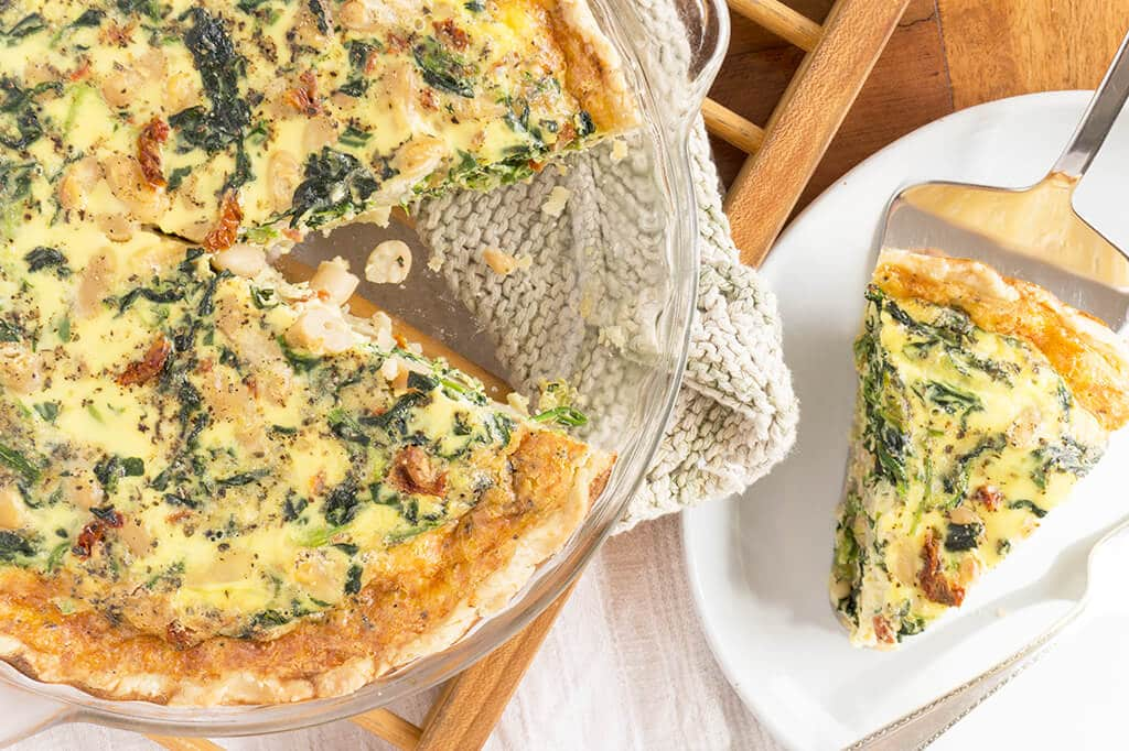 Spinach, White Bean & Sun Dried Tomato Quiche - slice on plate