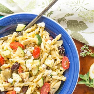 Pasta salad with tomatoes, olives, and zucchini