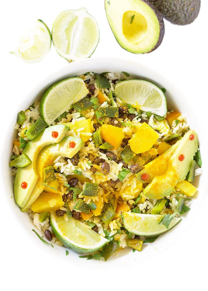 Tropical Black Bean sand Rice Bowl overhead with limes and avocado