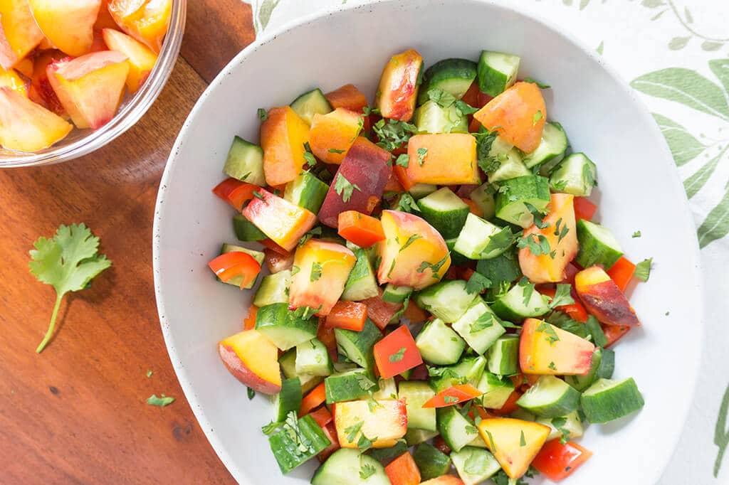 Sweet Peach Cucumber Salad in bowl overhead