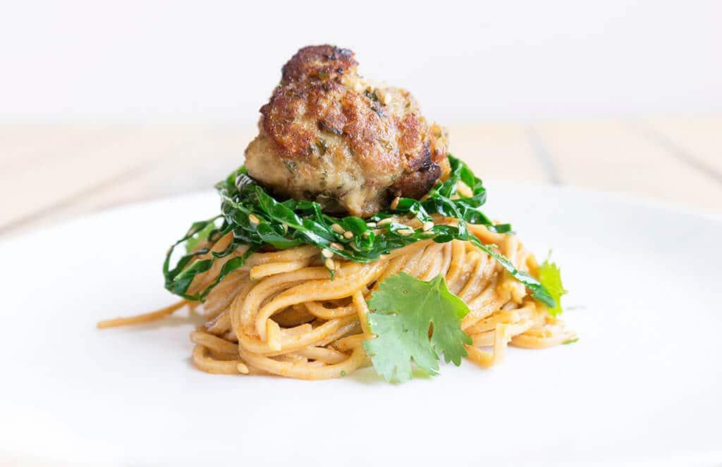 single meatball on noodles