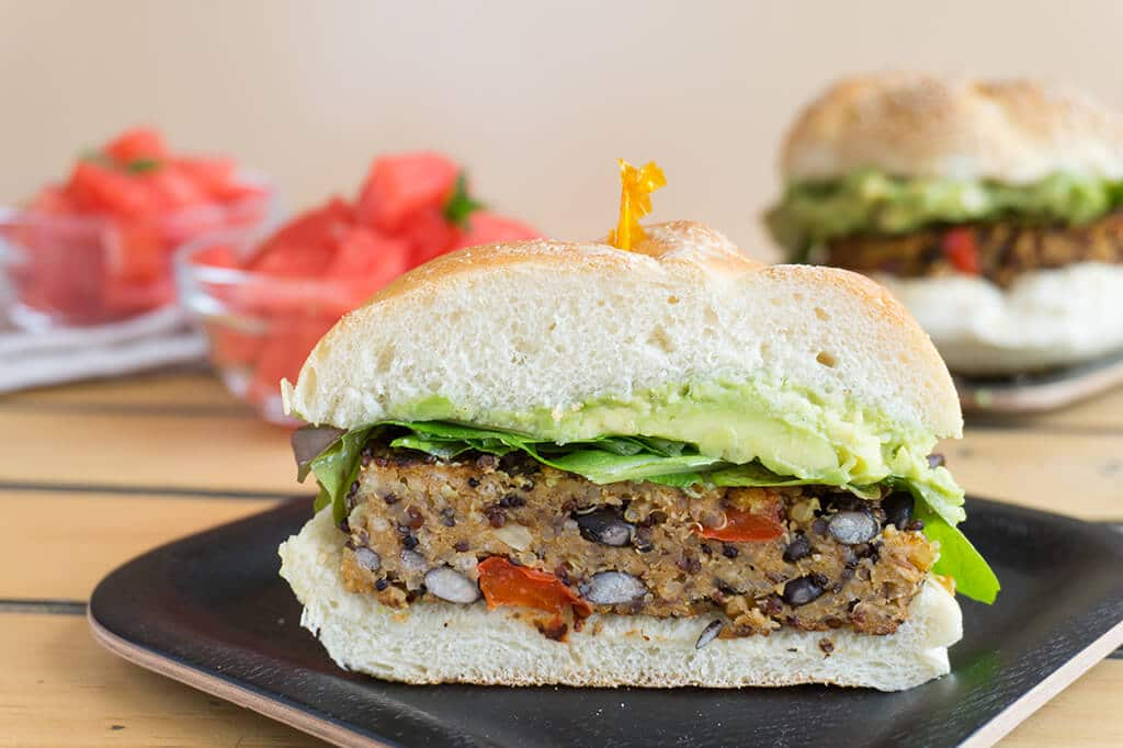 Black Bean Quinoa Burger on bun sliced in half