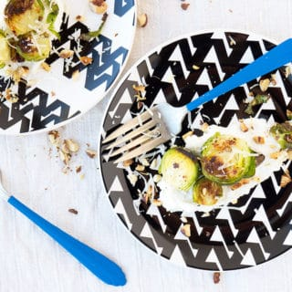 Brussel sprouts on plate with ricotta cheese