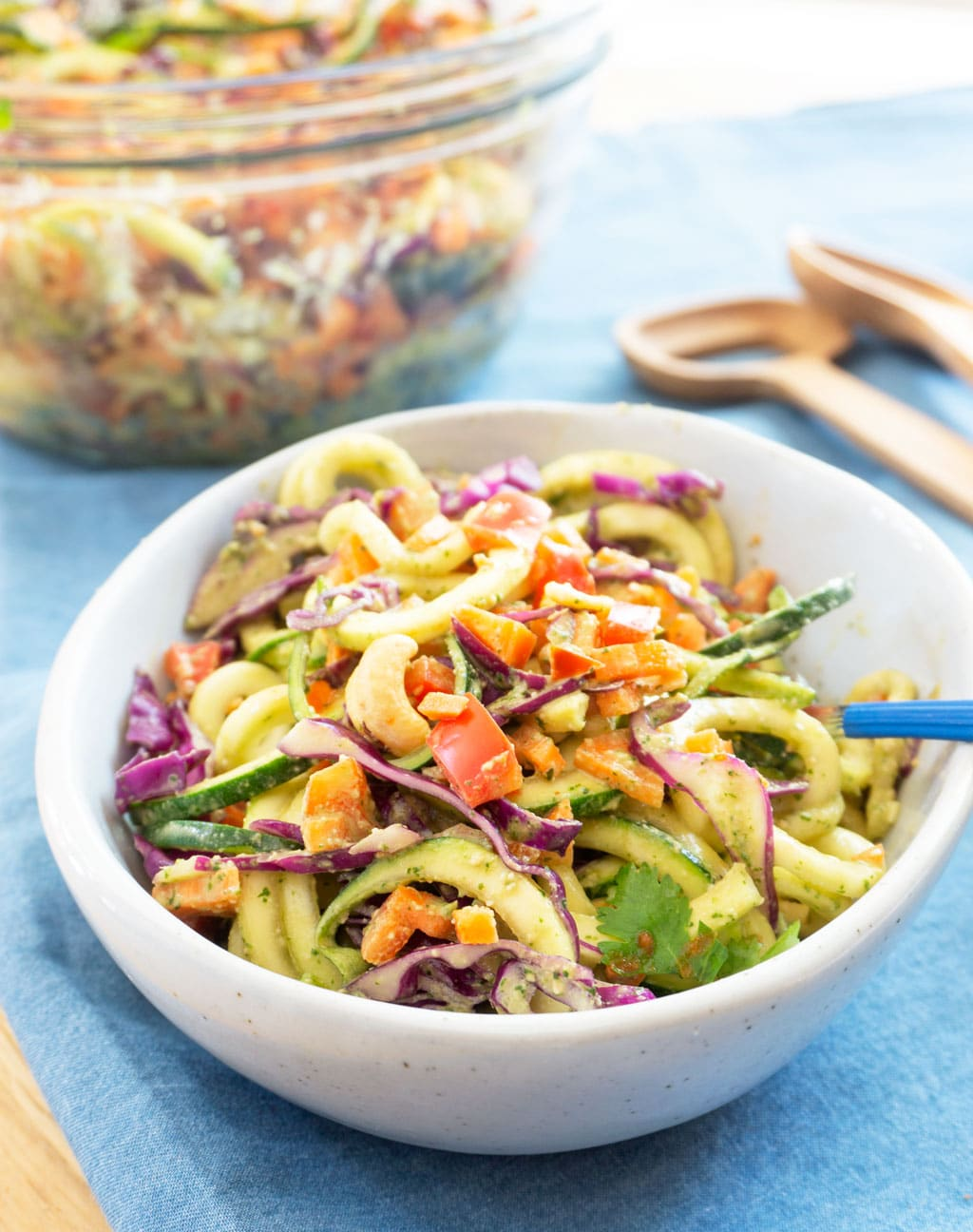 Vegan zoodle salad in single serving bowl with fork