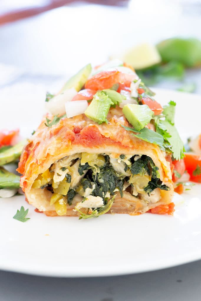 Chicken and Spinach Burrito cut on plate, vertical