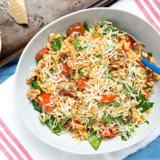 Spicy Roasted Tomato Pasta Salad in white bowl
