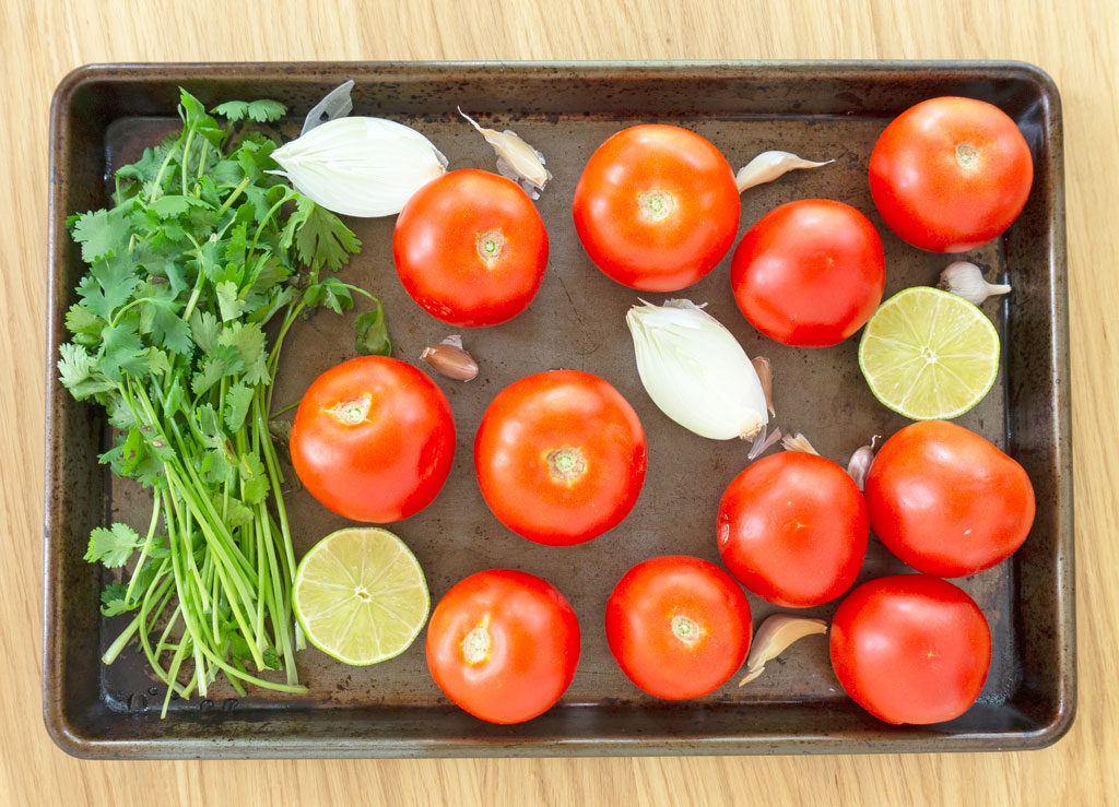 ingredients for fresh garden salsa on rimmed baking sheet