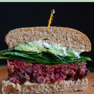 Black Bean Beet Burger on bun cut in half