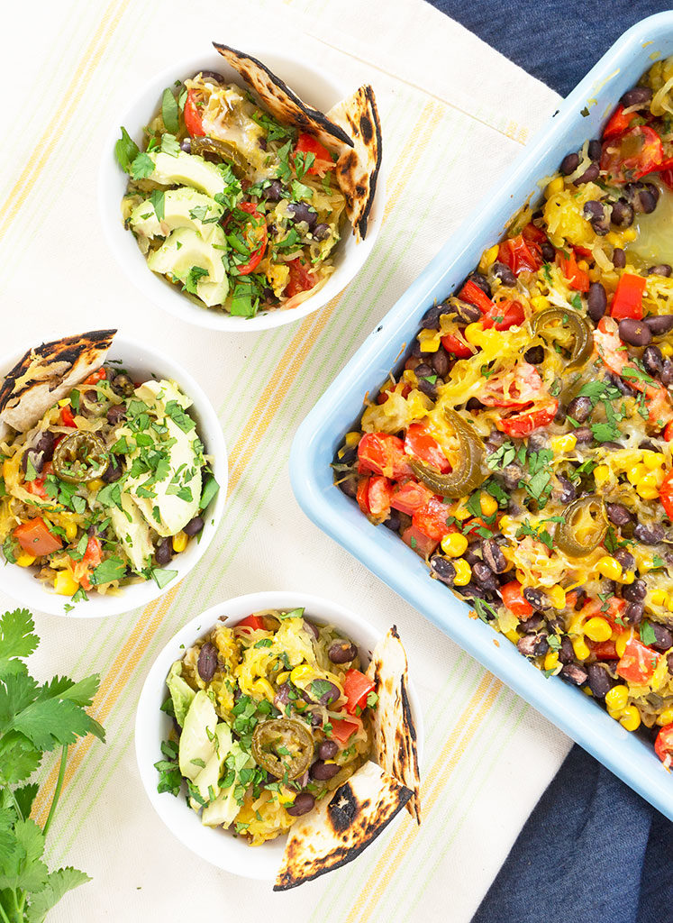 Mexican Spaghetti Squash bake with 3 bowls and casserole dish