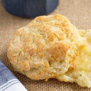 buttermilk biscuits cut in half with melted butter
