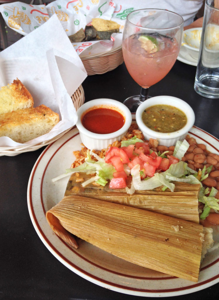 Tamales in husk with margarita and salsas