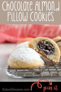 SECRET BALL OF CHOCOLATE INSIDE. Chocolate Almond Pillow Cookies have a secret to reveal. Inside these puffy little gems is a pocket of chocolate almond delight. | #HolidayRecipes | #AlmondCookies | #CookieRecipes at OatandSesame.com #oatandsesame