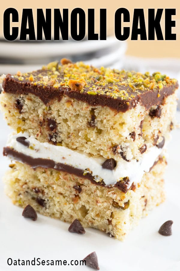 slice of cannoli cake topped with pistachios