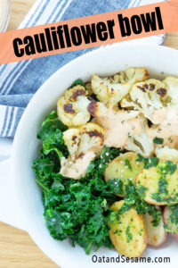 These vegan buddha bowls are packed with healthy ingredients then mixed with an addictive sauce. Perfectly roasted cauliflower, baby potatoes tossed in pesto, sautéed kale and a spicy chipotle mayo sauce elevates this dish to flavor heaven! #CAULIFLOWER | #BUDDHA BOWL | #HealthyRecipes at OatandSesame.com #oatandsesame