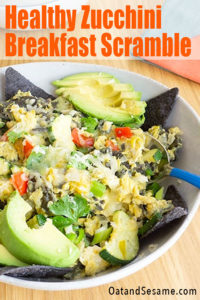 Layers of onions, peppers, zucchini and blue corn chips are tossed with eggs and spices for the ultimate Southwestern inspired breakfast bowl. | #BREAKFASTIdeas | #MIGAS | #ZUCCHINIRecipes | #HealthyRecipes at OatandSesame.com #oatandsesame